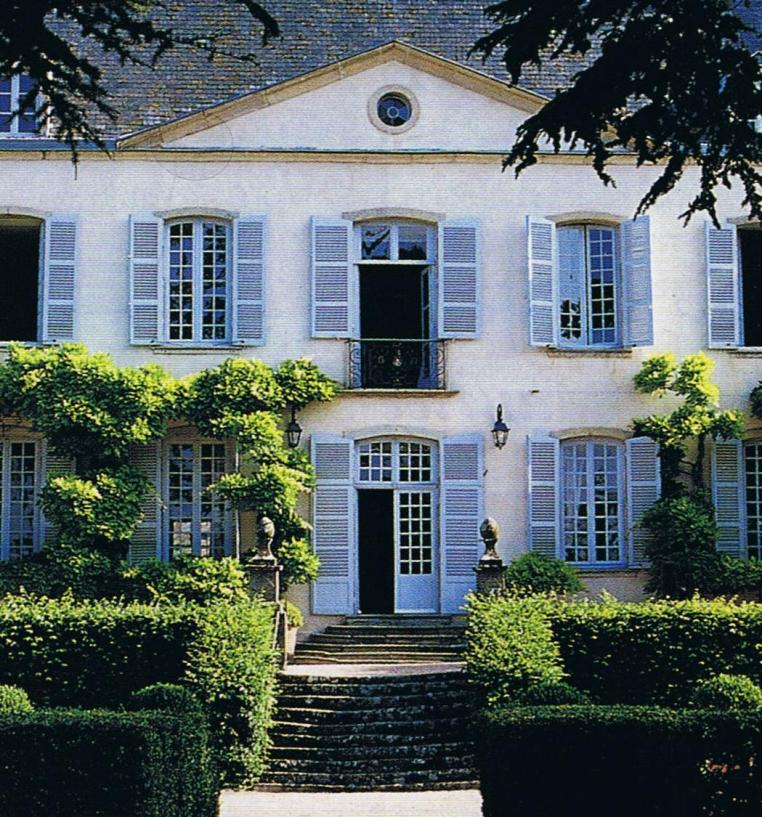 French Mansion with blue shutters