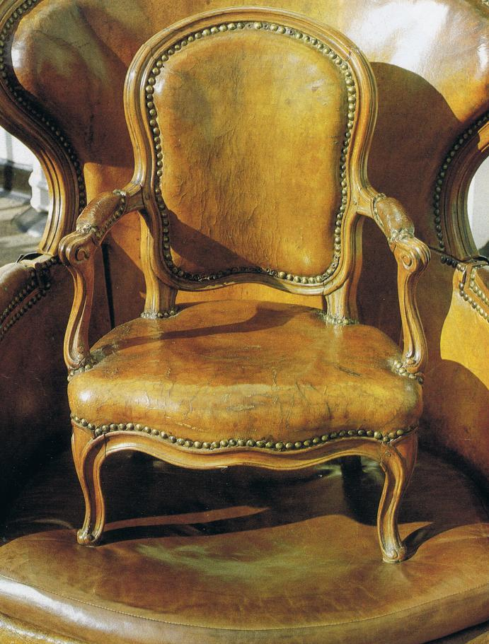 French Louis XV leather chair with child chair atop