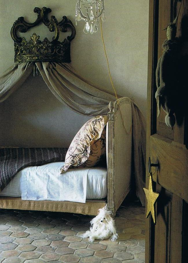 Antique corona topped French bed, cobbled floor in Provence.